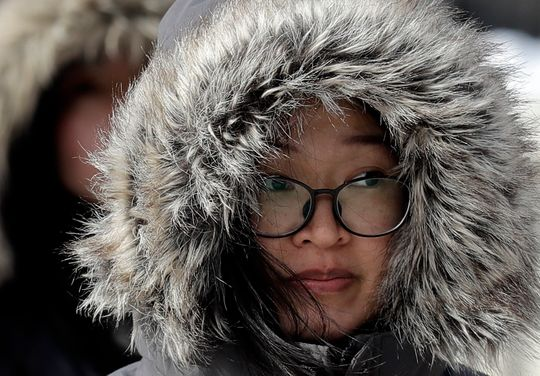 A woman is bundled up against Chicago's cold on Jan. 27, 2019.
