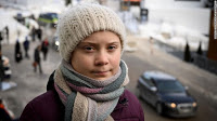 Swedish youth climate activist Greta Thunberg at the World Economic Forum in Davos, eastern Switzerland. (Photograph Credit: Fabrice Coffrini/AFP/Getty Images) Click to Enlarge.