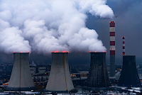 Smoke and steam rises from the Laziska coal-fired power plant near Katowice, Poland. (Credit: Monika Skolimowska/Picture-Alliance/DPA/AP Images) Click to Enlarge.