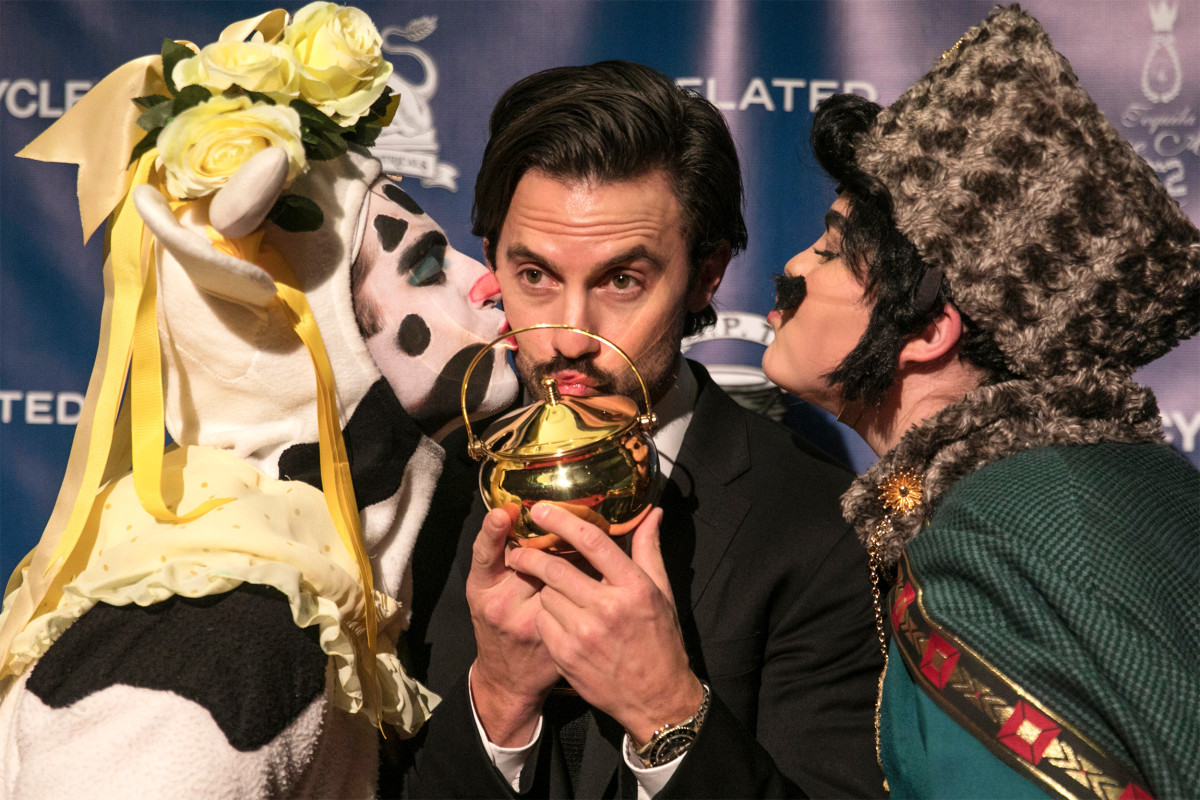 r Milo Ventimiglia kisses his pudding pot, flanked by Hasty Theatrical members Ryan Kapur '20 and Elle Shaheen '21.