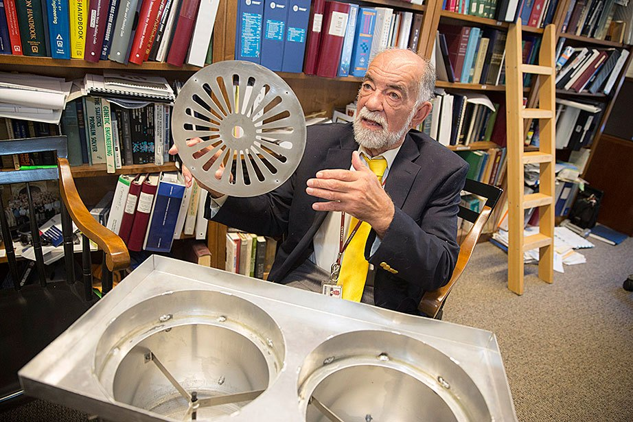 Tom Tribble, senior facilities manager at the Faculty of Arts and Sciences, explains how a device he designed helps reduce airflow in the Northwest Laboratory building, dramatically curbing energy use. The metal disk, which is manufactured at a campus machine shop, allows Tribble's team to reduce airflow without replacing the building's air conditioning system. Harvard's facilities leaders and building managers are working behind the scenes to optimize building energy systems and performance to improve efficiency and reduce greenhouse gas emissions.
