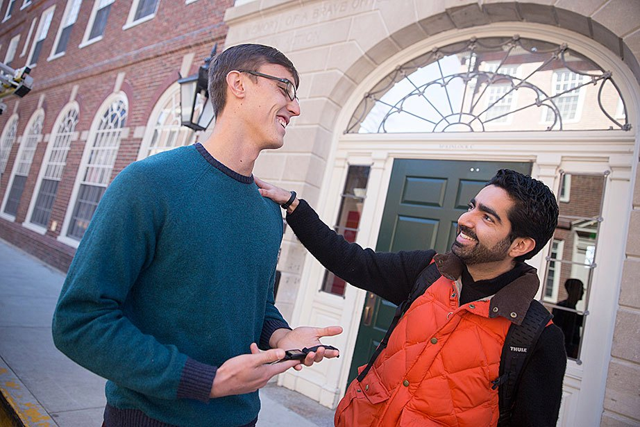 "Alex Hem '16, who works with the Undergraduate Resource Efficiency Program, talks with Jose ""Memo"" Guillermo Cedeño Laurent, a researcher at the Harvard T.H. Chan School of Public Health, outside the newly renovated McKinlock Hall at Leverett House. Hem participated in a ""living laboratory"" study led by Laurent, who won two Climate Change Solutions Fund grants at Harvard. This study monitors students' wellness, sleep, and fitness habits. ""We want to understand how buildings can enable our students not only to be the most accomplished, but also to be as healthy and happy as they can be,"" says Laurent."