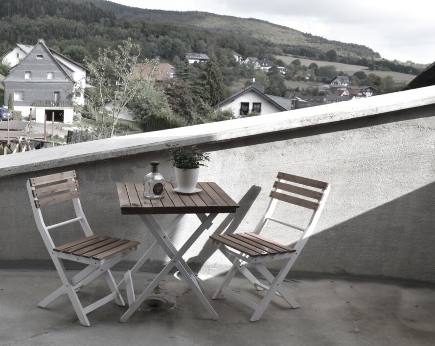 small dining set on outdoor deck
