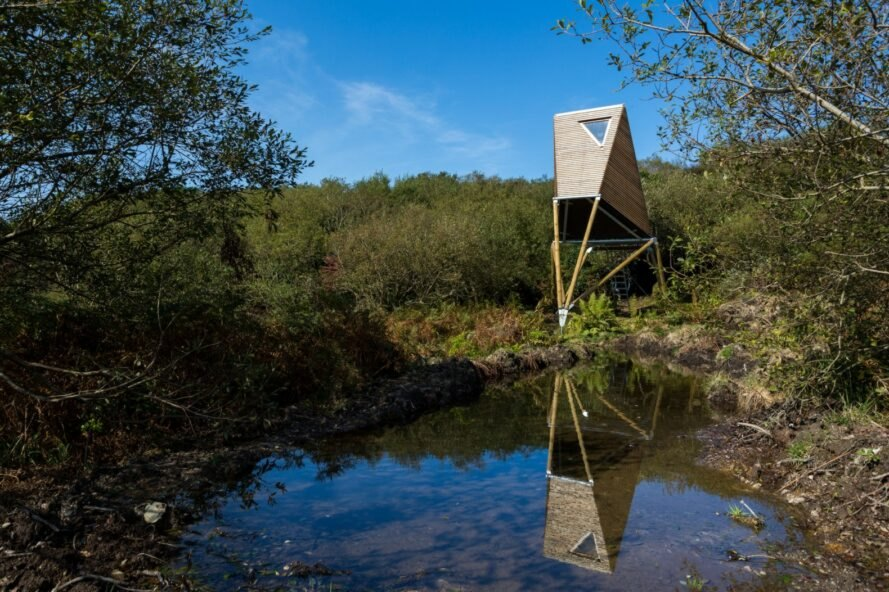 wooden angular cabin by water