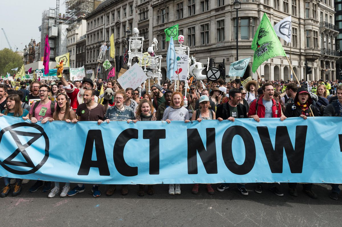Environmental activists from Extinction Rebellion march to Parliament Square on the ninth day of protest action, aiming to invite MPs to take part in people's assembly on climate and ecological crisis as they return to the Commons after Easter break, on 2