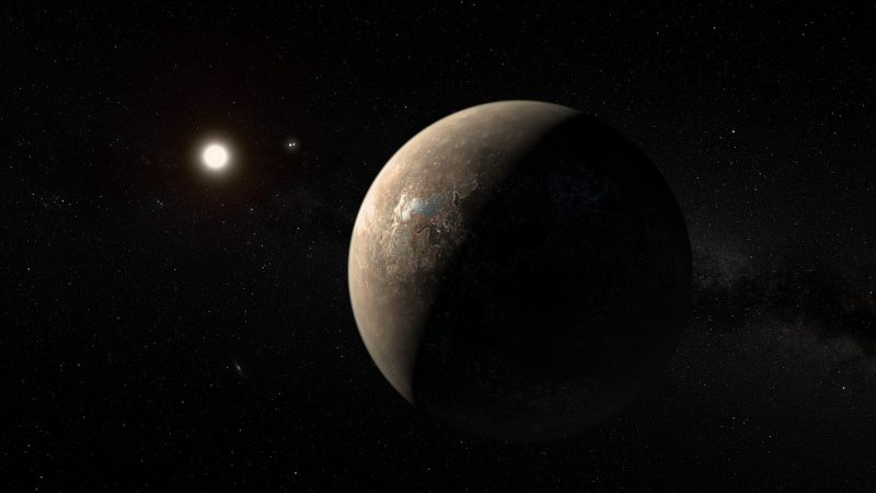 Brownish crescent view of planet with small sun in background.