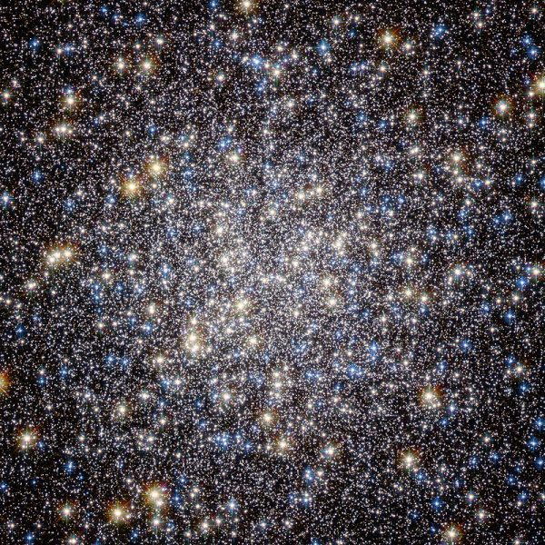 Round region of densely packed stars, density fading off at edges.
