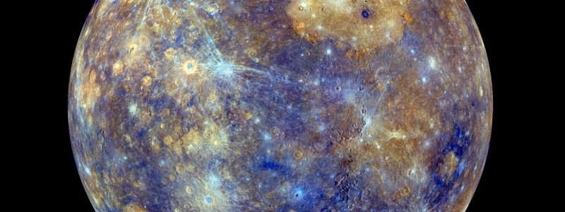 Mostly yellowish and blue blotchy planet with craters and their rays.