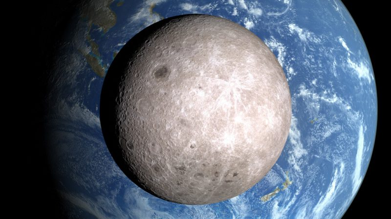 Back of gibbous moon with large Earth behind it.