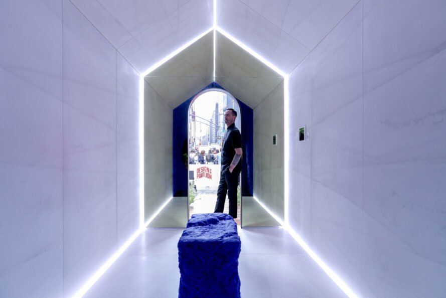 all white interior with man inside