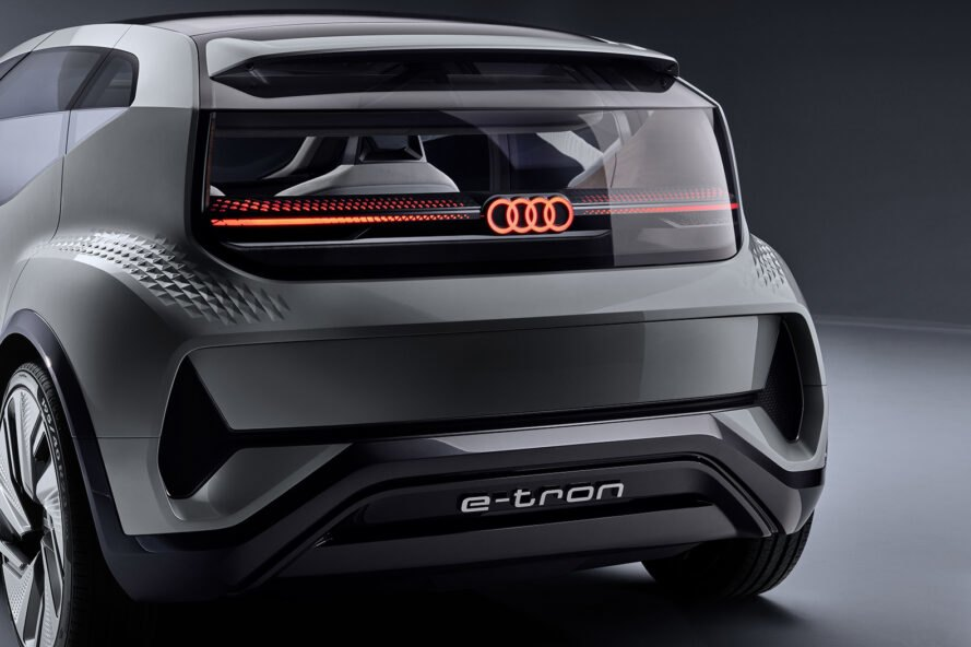 rendering of back of gray electric car