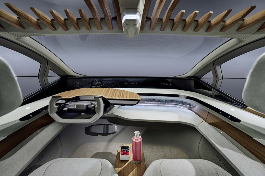 rendering of spacious car interior with light gray seats and wood accents