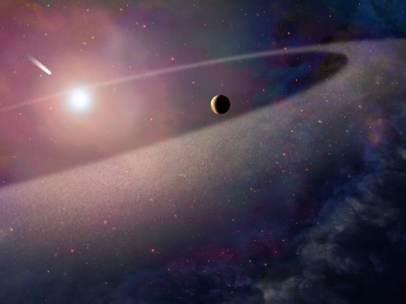 Small planet, big dust ring orbiting small white star.
