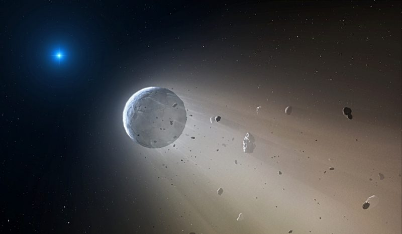 Brilliant blue-white star in background, planet with rocks flying off it in foreground.