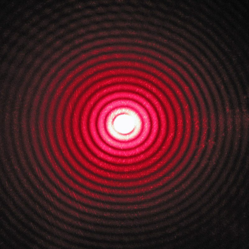Many concentric red circles, inner ones brighter, fading toward outside.