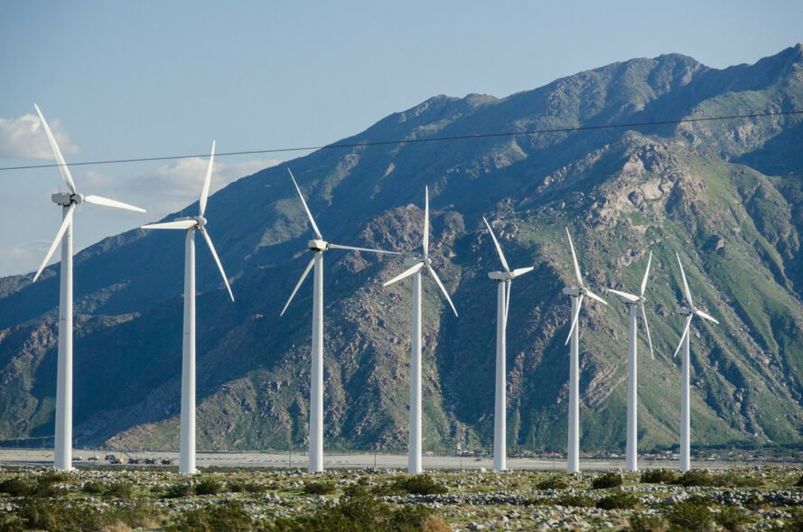 windmills in front of a mountain