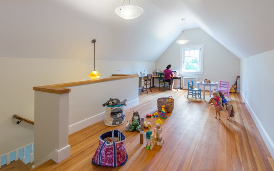 playroom with cathedral ceiling and white walls