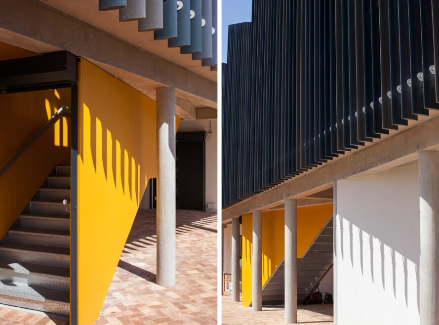 staircase leading to black and yellow building