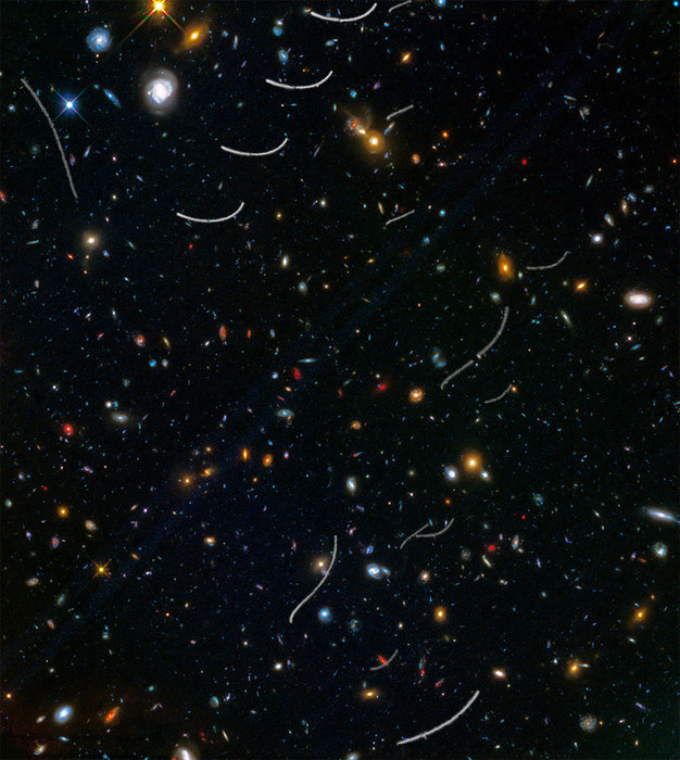 Colorful galaxy clusters and asteroid trails.