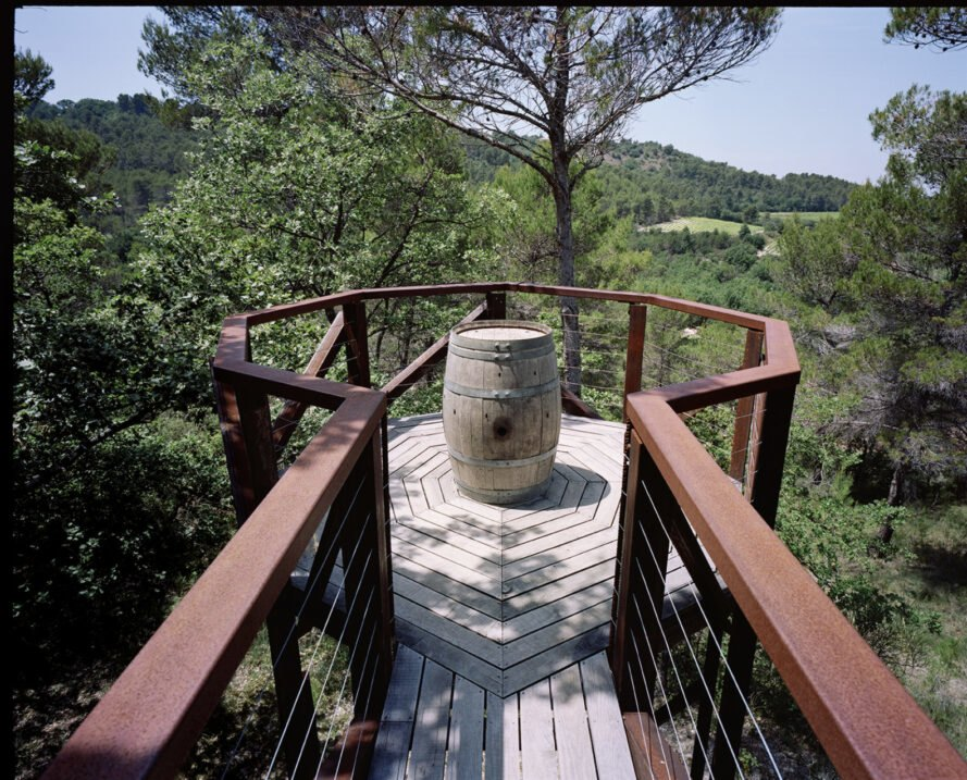 walkway leading out to wine barrel