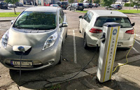 Electric cars at charging station in Storgata, Tønsberg, Norway. (Credit: Wikimedia Commons) Click to Enlarge.