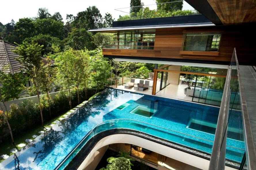 outside deck of home with large swimming pool