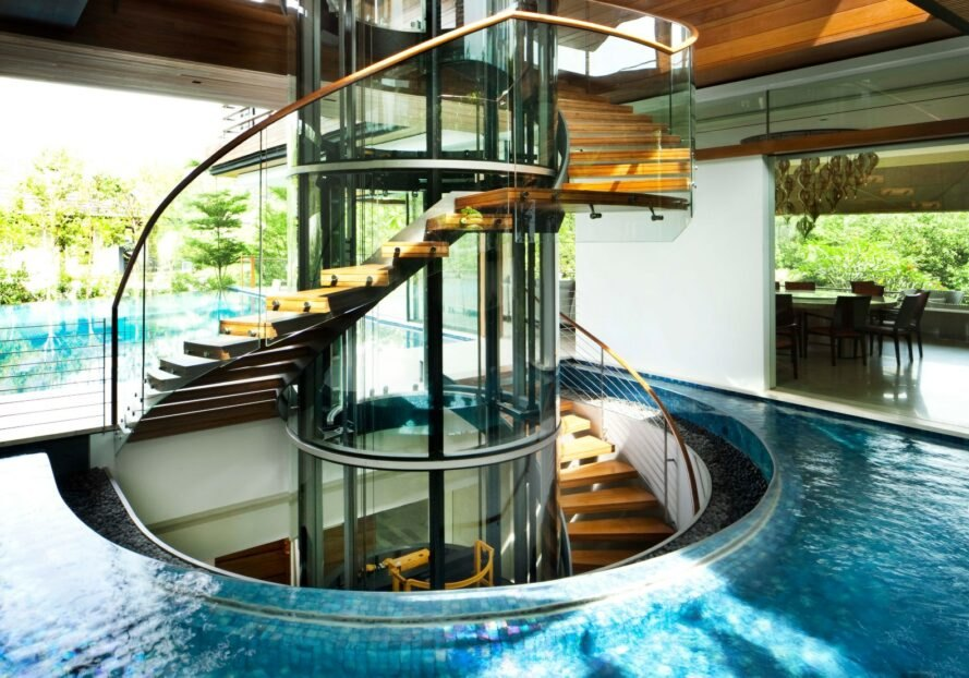 A rounded staircase surrounded by water