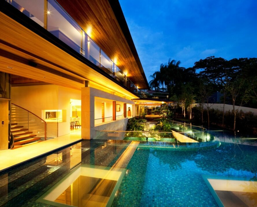 outside deck of home with large wrap-around swimming pool