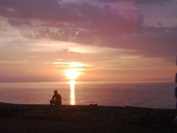 Contemplating the sunset on the Philippine island of Leyte. Photo by Abie Oquias Baybay.