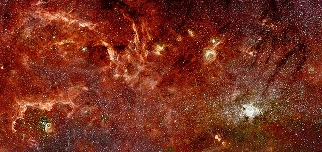 Dense starfield with bright patches, streaks, and blobs.