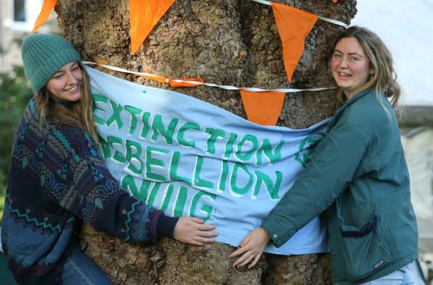 WELL ROOTED: Ruth Kiely and Hannah McSweeney, who study environmental science at Trinity College Dublin, at an Extinction Rebellion action at Merrion Square, Dublin, as part of a week of efforts to disrupt 60 cities around the world demanding drastic governmental action on climate change. Photograph: Stephen Collins/Collins Photos