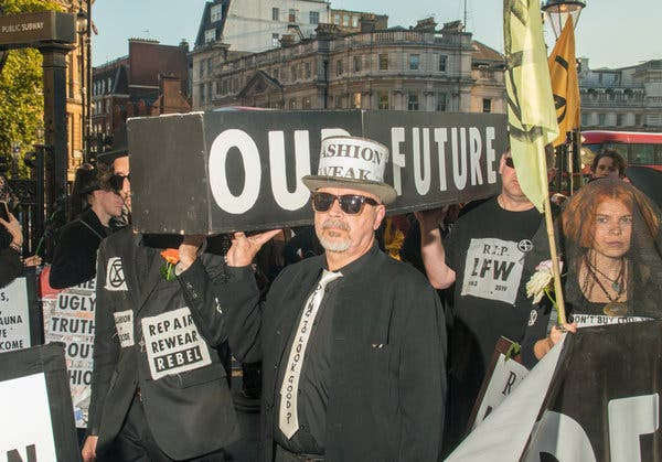 Extinction Rebellion protesters carrying a casket during the mock funeral for fashion last month.