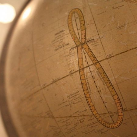 Globe with large figure 8 with intervals marked on it.