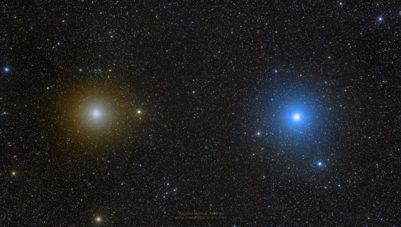 Two bright stars against a star field. Pollux appears as a light gold star while Castor appears blue-white.