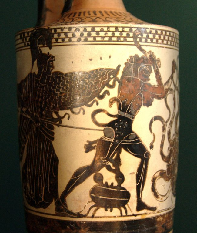 White pot with red and black scene of hero with Athena, large crab, and Hydra.