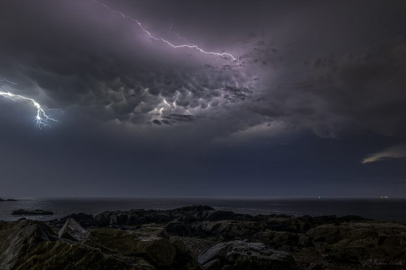Josh Blash caught these mammtus clouds illuminated by lightning over Rye, New Hampshire on July 4, 2014.