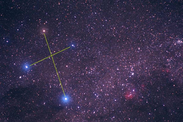 Star field with lines connecting four bright stars.