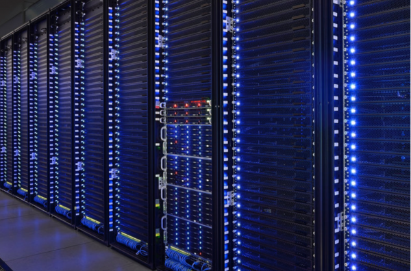 An array of tall computers, with blue lights.