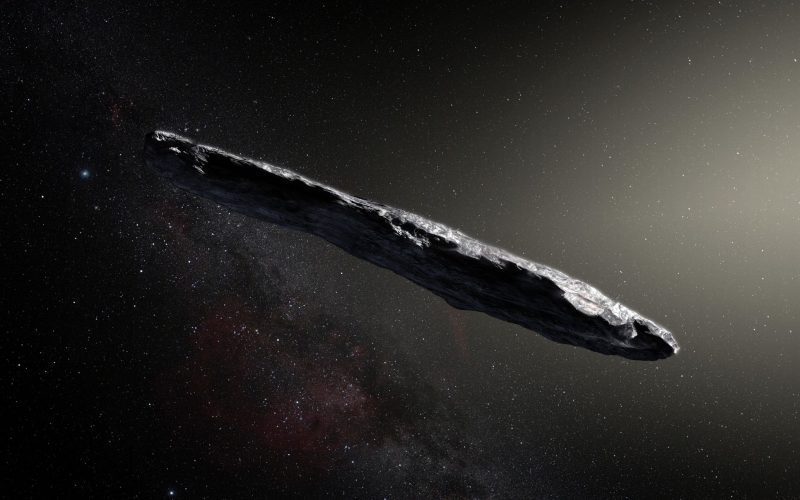 Long thin rocky object with stars in background.