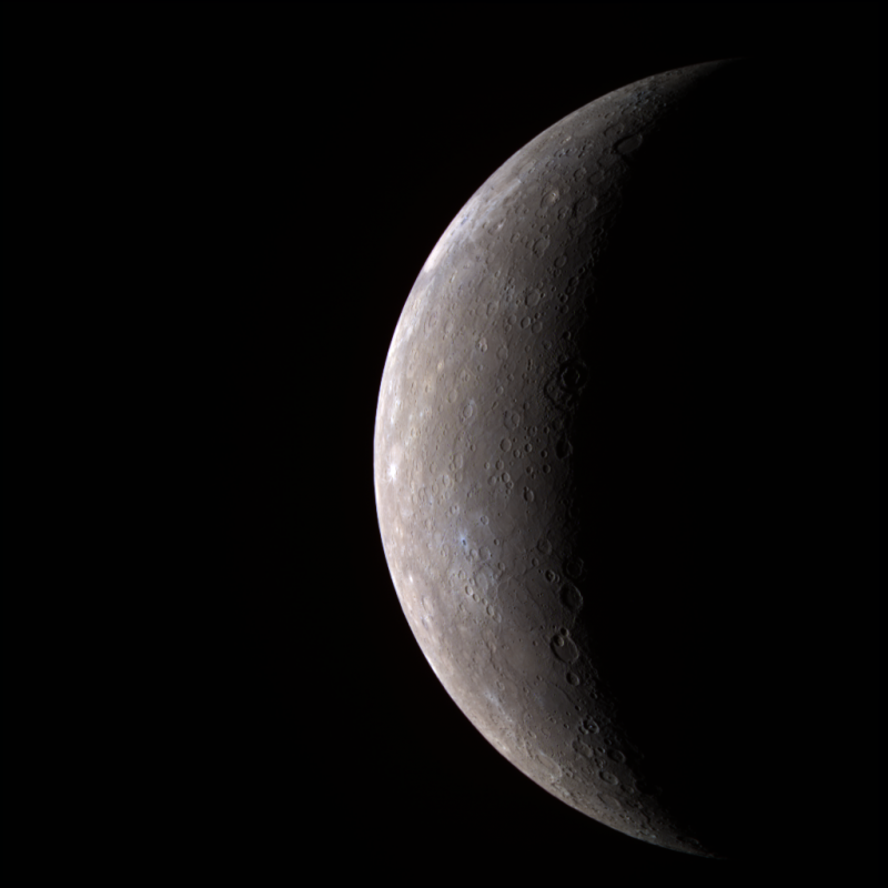 Crescent gray planet with smooth surface marked with shallow craters.