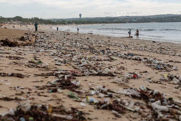 """Litter on Kedonganan Beach in Bali early this year.In late 2017, the government declared a """"garbage emergency"""" along some of the most popular tourist beaches."""