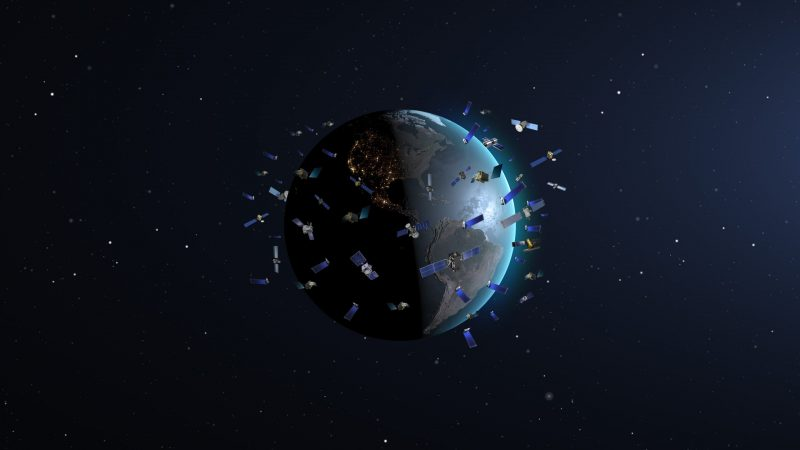 Illustration of Earth in space, surrounded by confetti-like halo of very many orbiting objects.