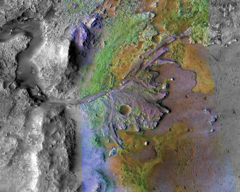 Colorful orbital view of rocky terrain with river channel and duck's foot shaped delta.