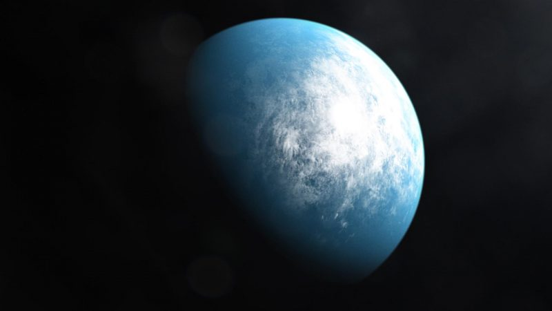 Bluish planet with white clouds in black space.
