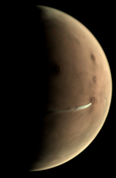 Large tan crescent with narrow white stream coming from a dark spot.