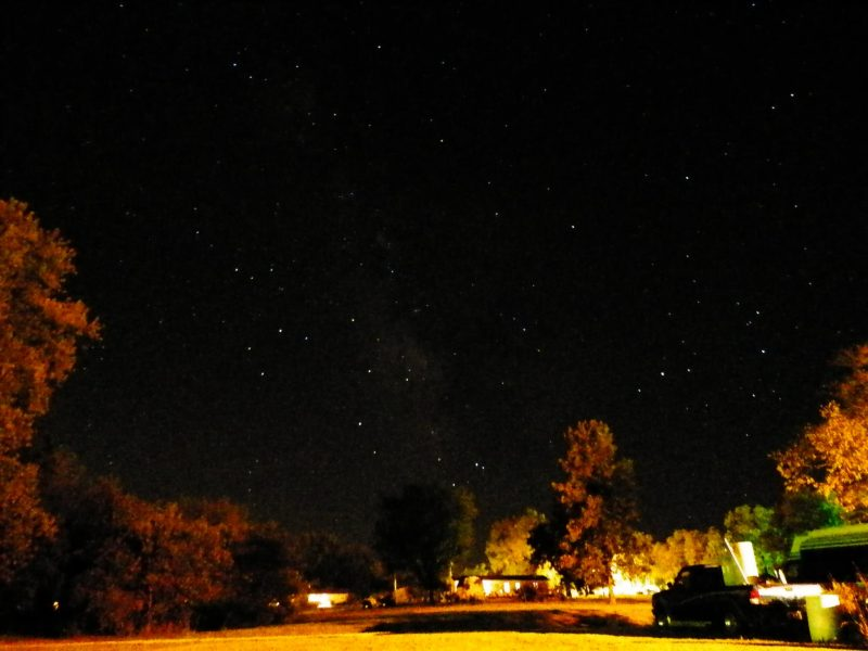 Starry night sky photo with the Milky Way almost vertical and bright Teapot stars.