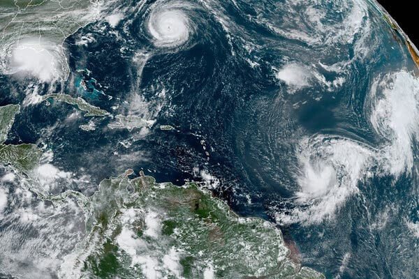Five storms churning in the Atlantic basin, from left: Hurricane Sally, Hurricane Paulette, the remnants of Tropical Storm Rene and Tropical Storms Teddy and Vicky.