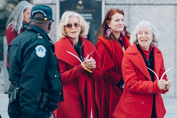 Ms. Fonda, center, after she was arrested and escorted out of the Hart Senate Office Building on the grounds of the Capitol on Nov. 1, 2019.