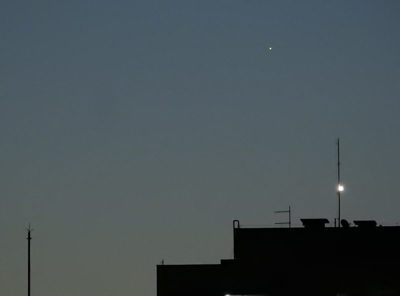 Mercury, setting behind a building.