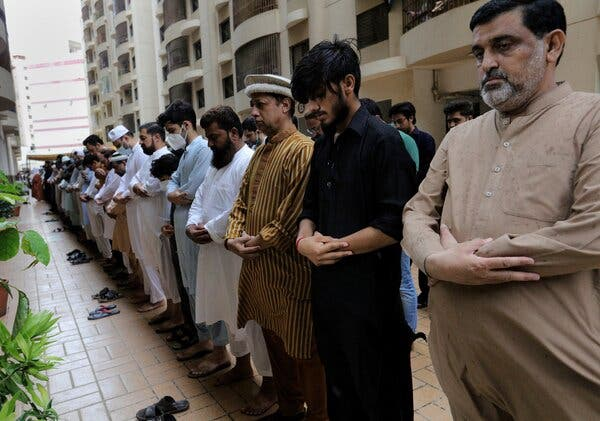 A funeral being held in Karachi, Pakistan, in August for some victims of the flood caused by relentless monsoon rains.